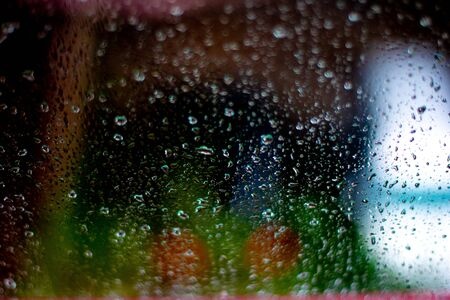Window splashed with raindrops. Large depth of field. Imagens