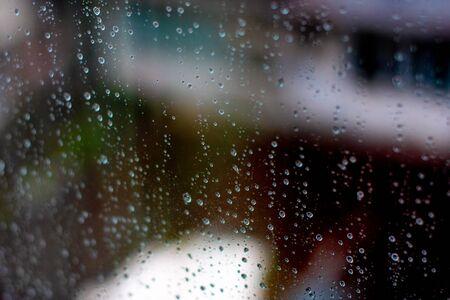 Raindrops on glass. Window splashed with raindrops. Imagens