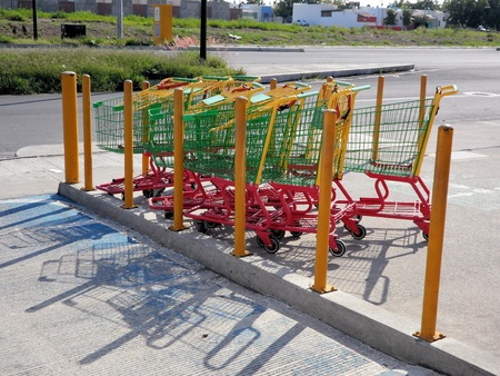 consumerism: Green  Red Shopping Carts Stock Photo