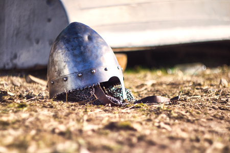 War steel helmet with rivets and net collar lying on the ground