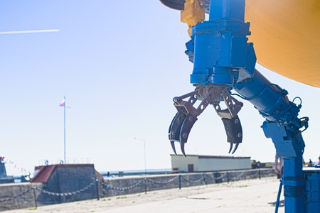 Mechanical arm open manipulator bathyscaphe on the background of the pier with copy space