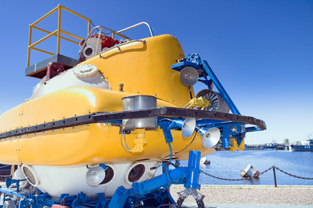 Large yellow rescue bathyscaphe with illuminators and mechanical manipulators
