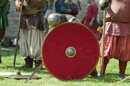 knight befor battle with round red shield