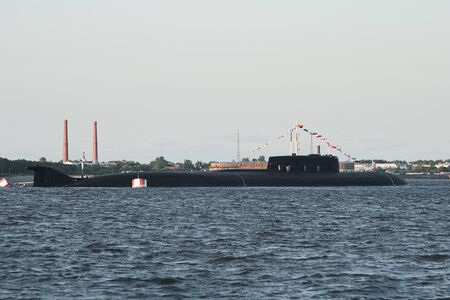Large Russian nuclear submarine stands at the parade in Kronstadt at the parade