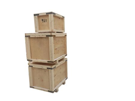 Boxes of plywood of different sizes are stacked on top of each other. Wooden industrial packaging with metal corners.