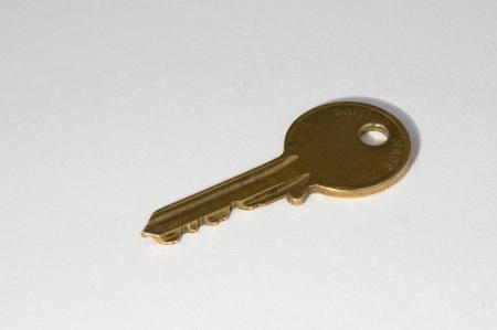 doorkey: Brass colour key on white background