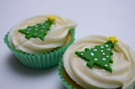 Two Christmas cup cakes Stock Photo