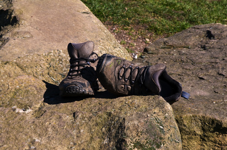Old walking shoes on stone