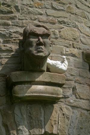 Dove and stone head Stock Photo
