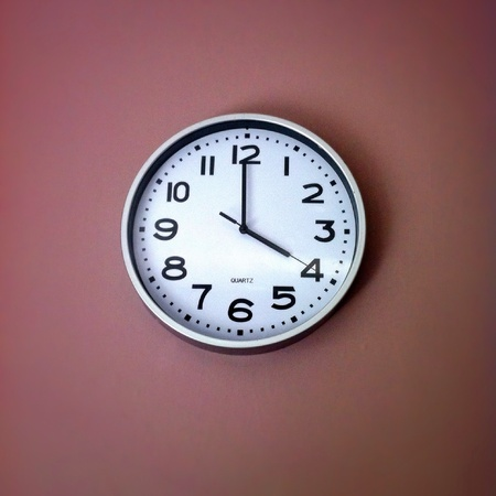 oclock: Kitchen clock showing 4 oclock Stock Photo