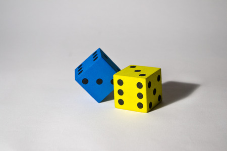 uncluttered: Foam dice on uncluttered background Stock Photo