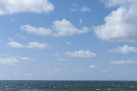 fluffy clouds: Sea and sky background with blue sky and fluffy clouds Stock Photo