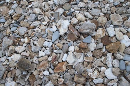 Jurassic pebbles background Stock Photo