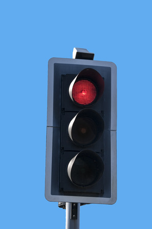 disapprove: Red traffic light against blue sky background. Stock Photo