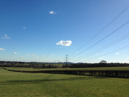 grid: National grid electricity power lines stretching across English farmland