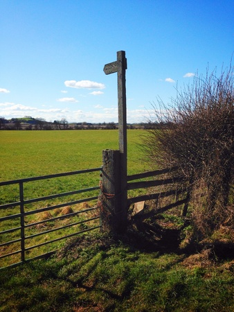 rickety: Footpath sign and rickety stile in Worcestershire UK. Sunny day and blue sky.