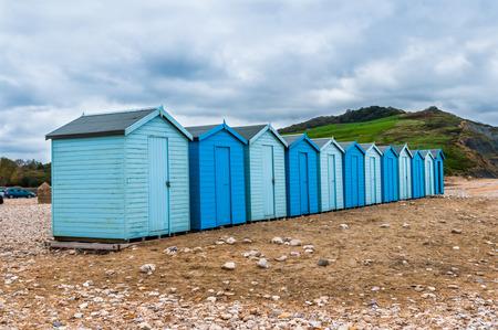 beach huts: Blue beach huts on diagonal. Stock Photo