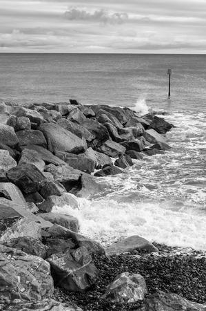 south coast: Breakwater on Britains Jurassic south coast. Stock Photo