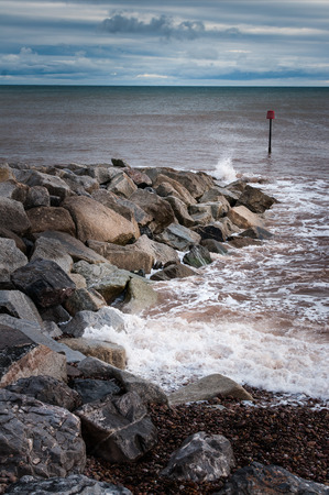 jurassic: Breakwater on Britains Jurassic south coast. Stock Photo