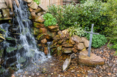 feature: Waterfall and sword in the stone garden feature.