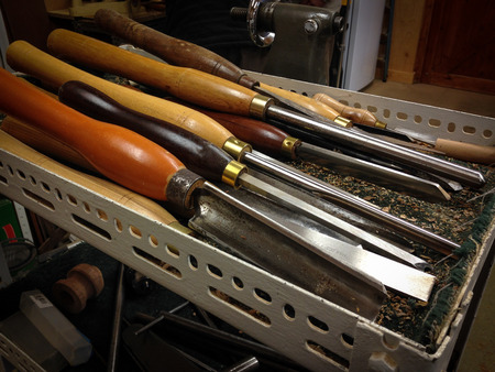 Woodworking chisels in wood-turners workshop.