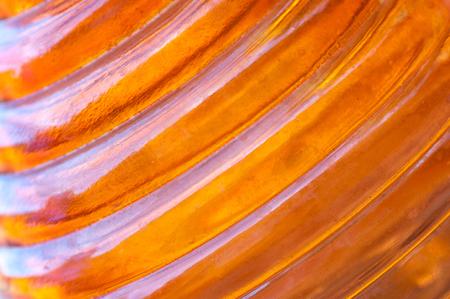 ridged: Ridged orange amber glass background.