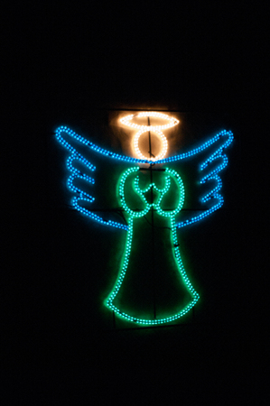 christmas angel lights illuminated against black background at night stock photo 66225651