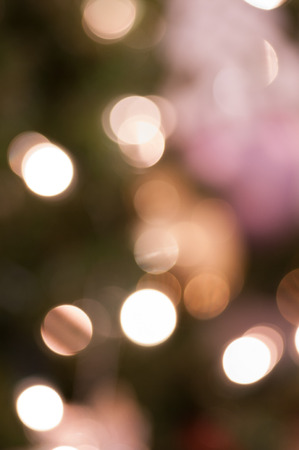 Bokeh Christmas background of lights and baubles.