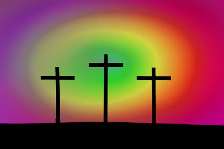 Three Easter crosses in silhouette with colorful background. Manipulated photograph.