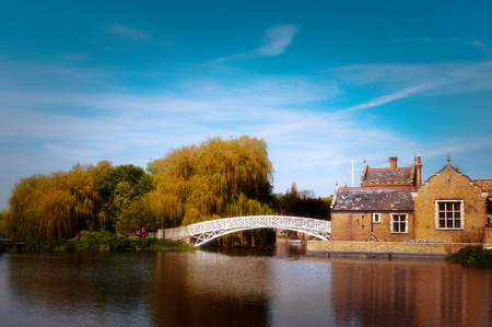 White Chinese Bridge on River Great Ouse spur at Godmanchester in Cambridgeshire. Stock Photo