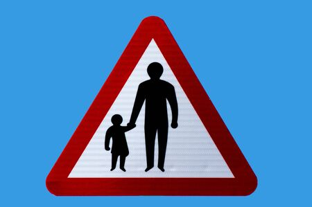Triangular road safety warning sign for pedestrians in road or no footway. Isolated. Stock Photo