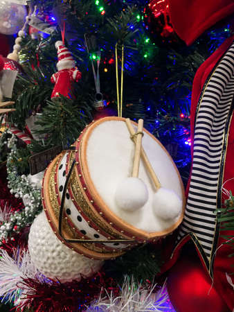 Toy drum Christmas ornament hanging on Christmas tree. Stock Photo