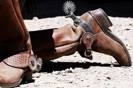 humility: Periodo corretto-Old West cowboy stivali e speroni  Archivio Fotografico