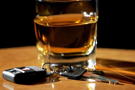 Drinking and Driving - Car keys and alcohol (shallow focus). Stock Photo
