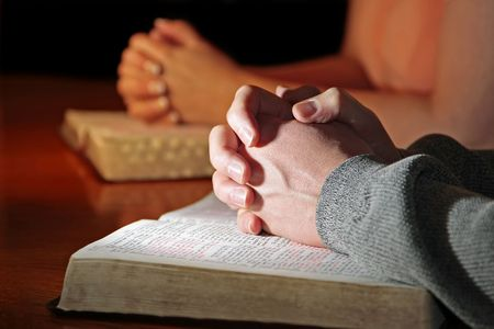 Couple Praying with Bibles photo