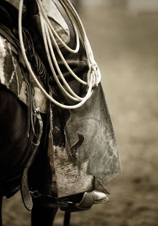 spurs: Working Cowboy Chaps & Rope (shallow focus, sepia tinted BW)