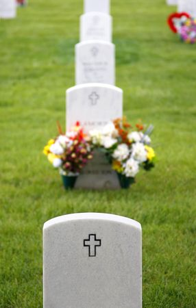 Military Cemetery Headstones and Flowers Stock Photo