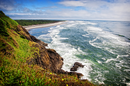 A scenic view of the pacific northwest coastline looking south from Cape Disappointment state park in Washington, USA.
