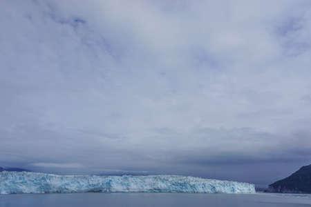 Disenchantment Bay, Alaska, USA: Clouds descend on the Hubbard Glacier in Alaska.