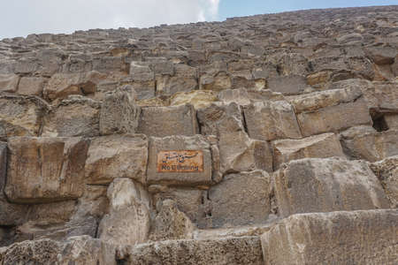 Giza, Egypt: A sign in Arabic and English at the Khufu pyramid complex warns visitors not to climb the Great Pyramid.