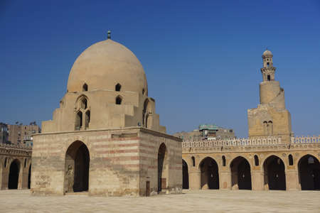 Cairo, Egypt: Ablution fountain and minaret of the Mosque of Ibn Tulun (879 AD), the oldest in Cairo surviving in its original form and the largest. Stock fotó