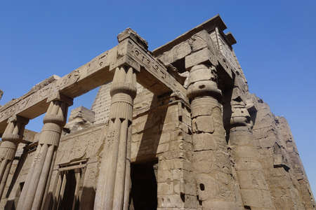 Luxor, Egypt: Columns covered with hieroglyphs at Luxor Temple, built in 1400 BC on the east bank of the Nile River.