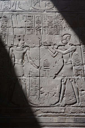 Luxor, Egypt: Carvings and hieroglyphs on a wall at Luxor Temple, built in 1400 BC on the east bank of the Nile River. Stock fotó