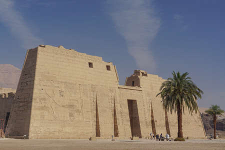 Luxor, Egypt: The first pylon of Medinet Habu, New Kingdom mortuary temple of Ramesses III on the West Bank of the Nile River.