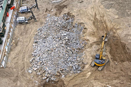 A pile of Manhattan schist that has been extracted from bedrock as construction begins on a high-rise building in midtown Manhattan, New York City.