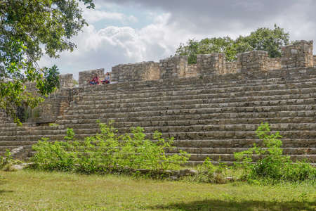 Dzibilchaltun, Yucatan, Mexico: Two women meditating on Structure 44, a 425-foot long platform with a continuous stair.