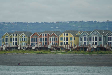 Homer, Alaska: A row of colorful houses sits on the beach at the tip of Homer Spit, in Kachemak Bay.