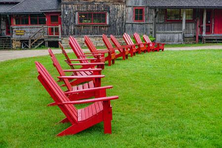 Sagamore Lake, NY: A row of Adirondacks chairs on the lawn at the Great Camp Sagamore, built in 1897. Sajtókép
