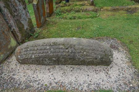 Luss, Scotland: 11th century Viking Hogback grave stone at the St. Kessog Church (1875) on Loch Lomond.