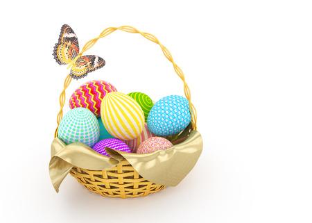 mariposas amarillas: Cesta con los huevos de Pascua de colores y mariposas amarillas sobre fondo blanco Foto de archivo